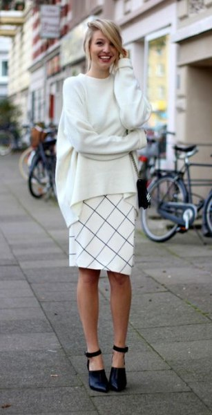 white chunky crew neck knit sweater with plaid knee length skirt