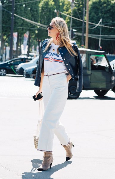 white cool graphic tee with black leather jacket and wide leg pants