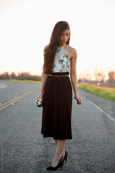 white floral printed halter top with black midi high rise skirt
