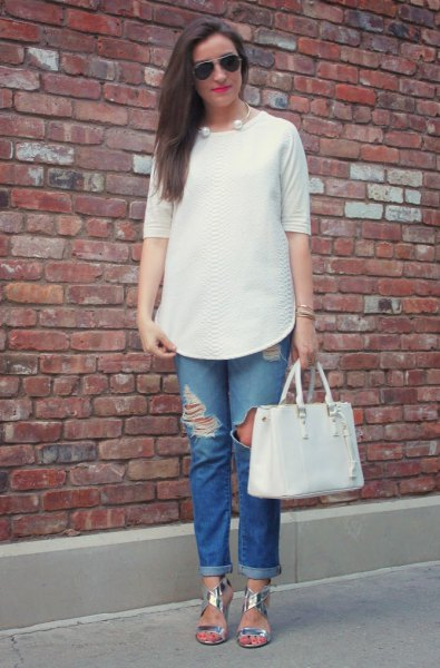 white half sleeve buttonless blouse with ripped cuffed blue jeans