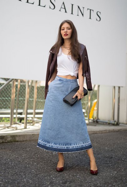 white knotted tee with black leather jacket and long flared skirt