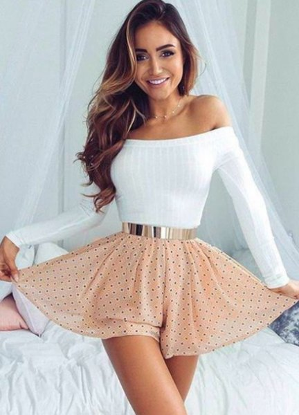 white off the shoulder form fitting sweater with blush pink polka dot high rise skater skirt