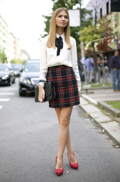 white ribbon bow button up shirt with navy blue and red mini skirt
