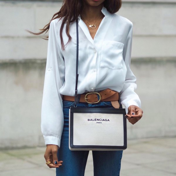 white silk button up shirt with blue high waisted jeans