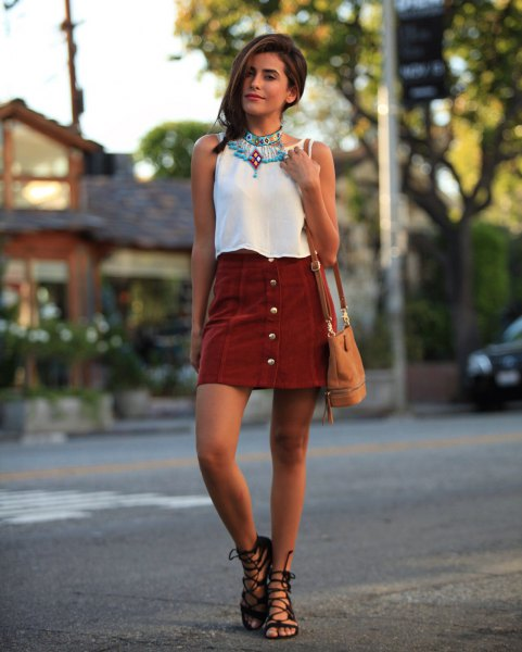 white sleeveless blouse with grey button front mini skirt