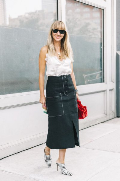 white sleeveless ruffle top with black relaxed fit high waisted maxi skirt