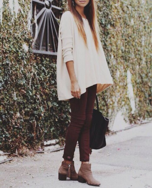 white tunic sweater with skinny jeans and grey leather ankle boots