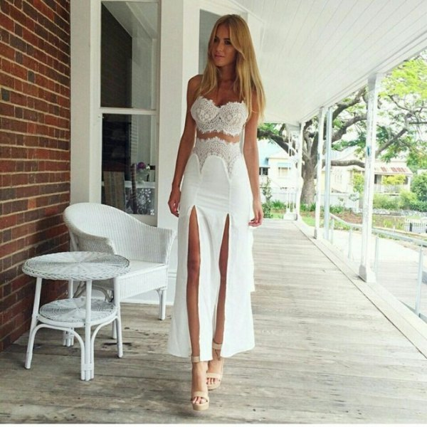white two piece double slit prom dress with pink heels