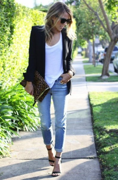 black blazer with white tank top and light blue cuffed jeans