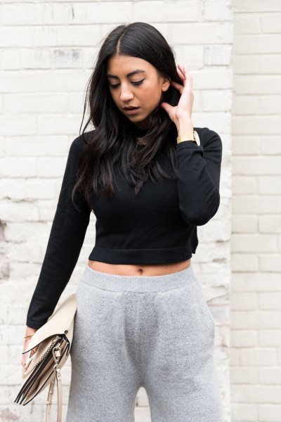 black cropped turtleneck sweater with grey wide leg knit pants