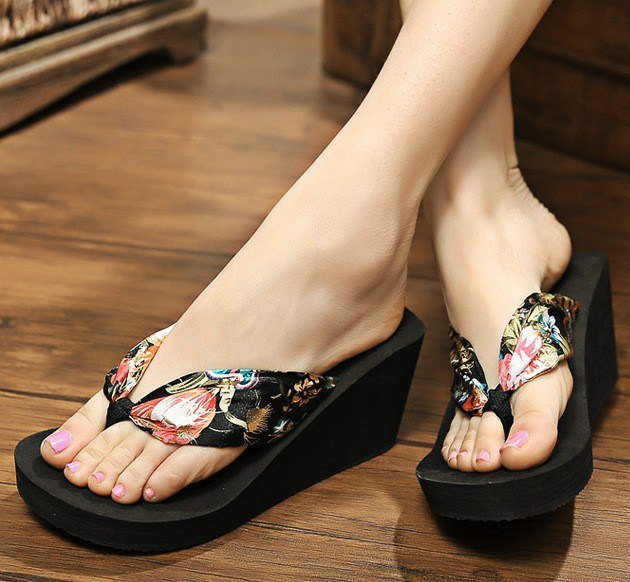 black floral printed wedge flip flops with white mini shift dress
