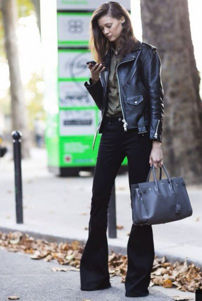black leather biker jacket with burgundy button up shirt and flared jeans