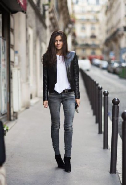 black leather jacket with white oversized tee and grey skinny jeans