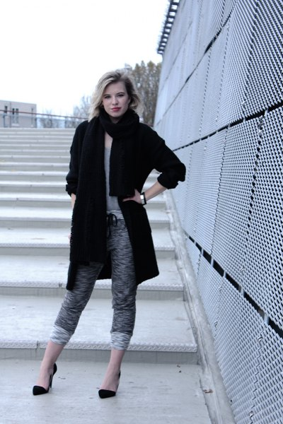 black long wool coat with heather grey cropped knit pants
