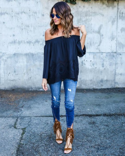 black off the shoulder blouse with skinny blue jeans