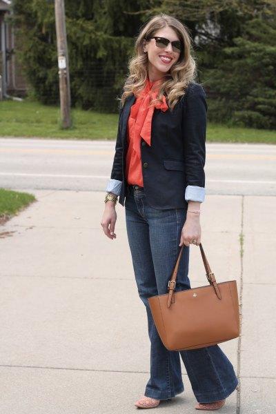 black shirt with orange bow tie and blazer