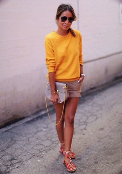 bright lemon yellow pullover sweater with pink shorts and silver summer sandals