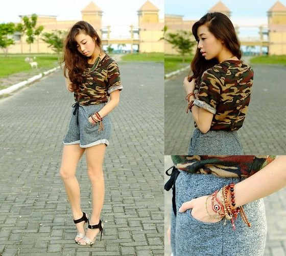 camo t shirt with grey high waisted sweatpant shorts and heels