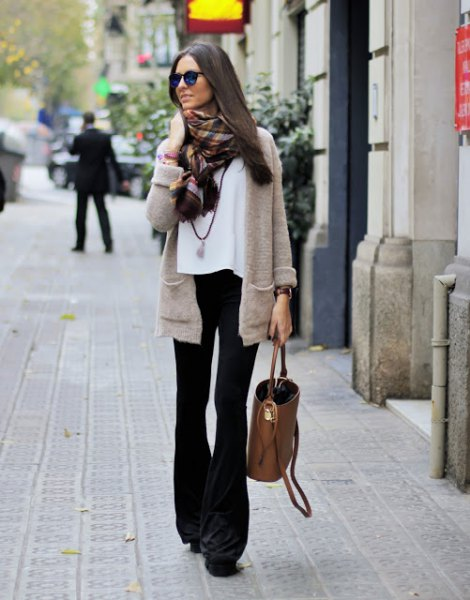 grey cardigan with white chiffon blouse with black flared jeans