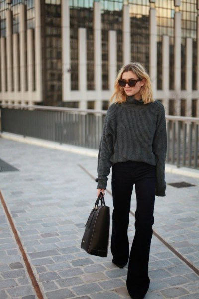 grey crew neck chunky sweater with black flared jeans