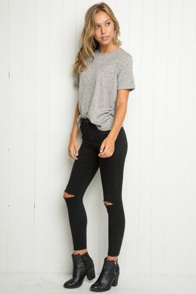 grey oversized t shirt with black ripped skinny jeans and leather boots