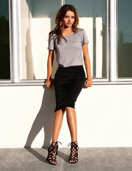 grey t shirt with black midi skirt and strappy lace up heels