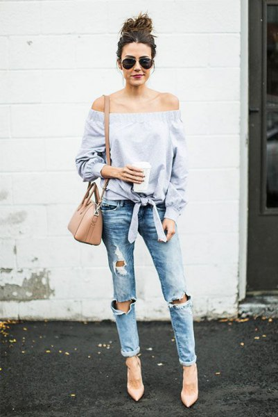 light blue knotted off the shoulder blouse with heavily ripped jeans