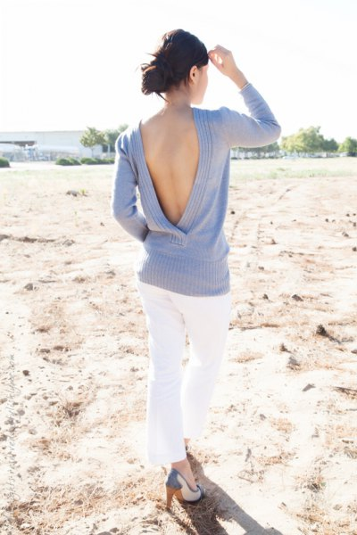light sky blue open back sweater with white skinny jeans