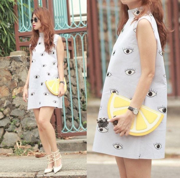pink graphic mini mock neck dress with lemon printed clutch handbag