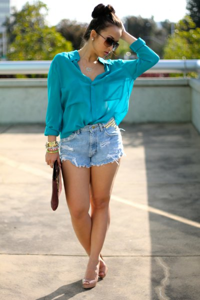 purple chiffon blouse with distressed denim shorts