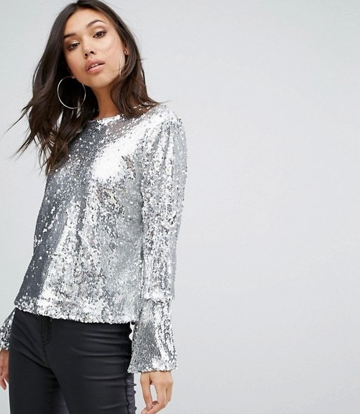 silver sequin long bell sleeve top with black coated skinny jeans