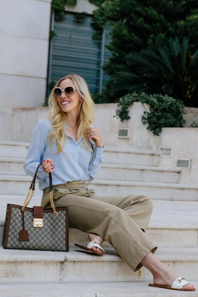 sky blue chiffon blouse with grey chinos and white slide sandals