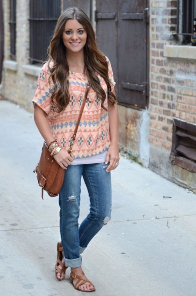 tribal printed pale yellow top with blue cuffed jeans