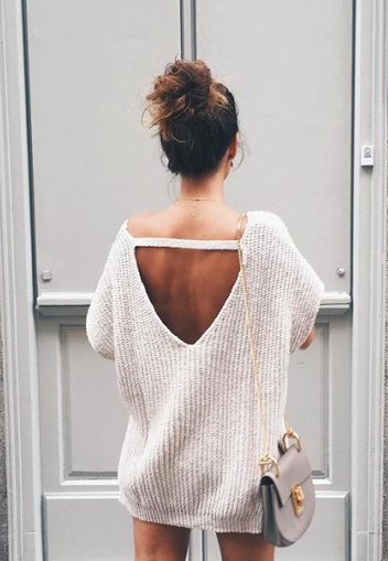 white chunky oversized open back sweater with mini shorts
