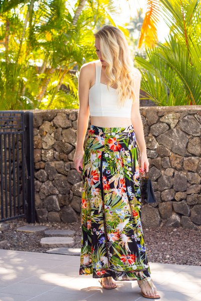 white cropped form fitting top with floral printed maxi chiffon skirt