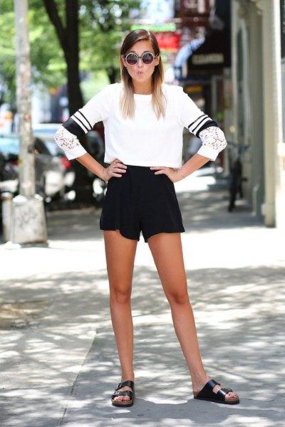 white cropped sweatshirt and black high waisted sweat shorts