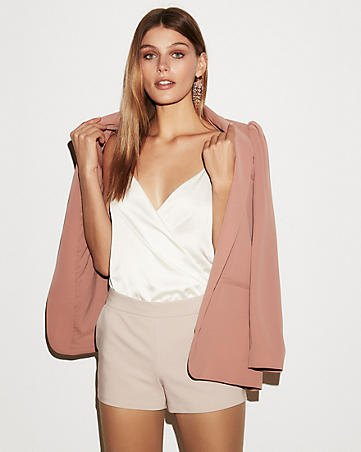 white deep v neck going out top with pink shorts and blush blazer