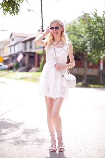 white gathered waist mini lace dress with grey strappy flat sandals