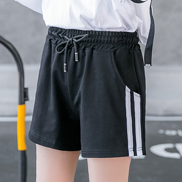 white long sleeve t shirt with black running shorts