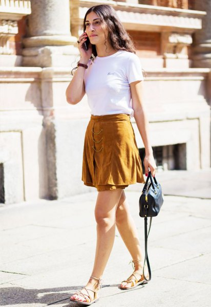 white short sleeve t shirt with green mini skater skirt