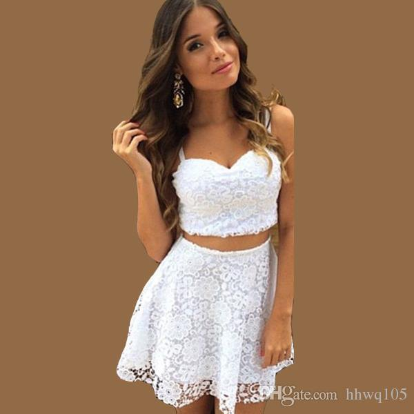 white sweetheart neckline crop top with mini lace skirt