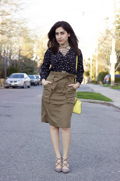 black and white polka dot blouse with high rise green cargo skirt