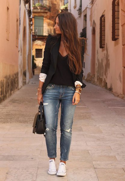 black blazer with deep v neck blouse and blue ripped jeans