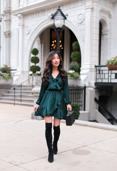black blouse with mini skater ruffle skirt and flat knee high boots