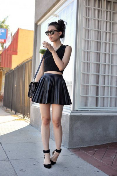 black cropped tank top with mini skater pleated leather skirt