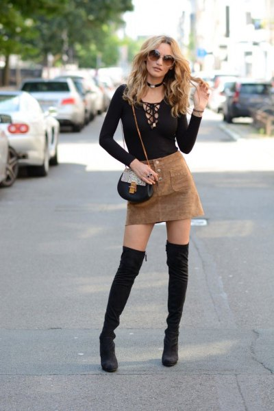 black cutout front long sleeve tee with camel mini suede skirt