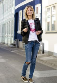 black denim blazer with ripped blue jeans and animal print canvas shoes