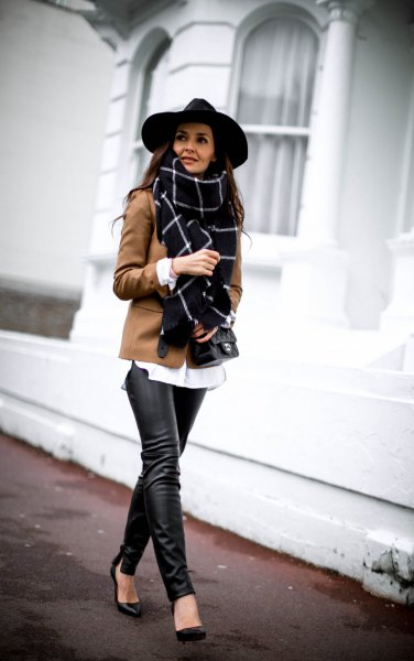 black felt hat and brown blazer and leather leggings