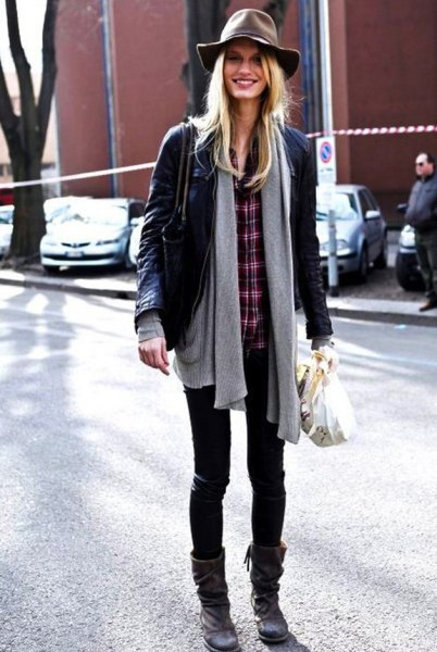 black leather jacket with grey cardigan and plaid shirt