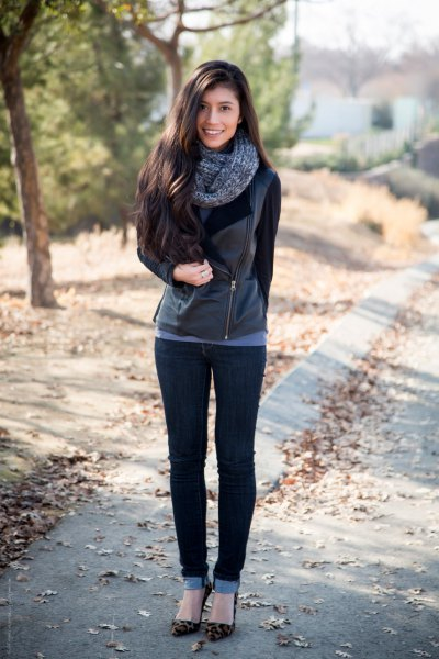 black leather moto jacket with cuffed skinny jeans